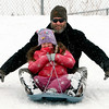 "Eve Goebel and her dad, Ed,take off during  a day of sledding at a hill near Sunset Middle School on Sunday Feb. 24, 2013.<br /> For more photos sledding, go to  <a href=""http://www.timescall.com"">http://www.timescall.com</a>.<br /> Cliff Grassmick / February 24, 2013"