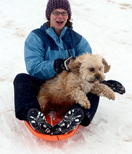 Sasha Richardson and her dog, Marley, try  a day of sledding at a hill near Sunset Middle School on Sunday Feb. 24, 2013. For more photos sledding, go to www.timescall.com. Cliff Grassmick / February 24, 2013