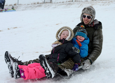 Cameron, left, Mallory, and Travis Gahn take off down the hill for a day of sledding near Sunset Middle School on Sunday Feb. 24, 2013.  For more photos sledding, go to www.timescall.com. Cliff Grassmick / February 24, 2013