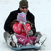"Eve Goebel covers her face while dad, Ed, keeps the sled up during  a day of sledding at a hill near Sunset Middle School on Sunday Feb. 24, 2013.<br /> For more photos sledding, go to  <a href=""http://www.timescall.com"">http://www.timescall.com</a>.<br /> Cliff Grassmick / February 24, 2013"