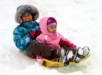 Loreann Laou, and her sister, Chloe, pick up speed during a day of sledding at a hill near Sunset Middle School on Sunday Feb. 24, 2013. For more photos sledding, go to www.timescall.com. Cliff Grassmick / February 24, 2013