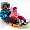 "Loreann Laou, and her sister, Chloe, pick up speed during a day of sledding at a hill near Sunset Middle School on Sunday Feb. 24, 2013.<br /> For more photos sledding, go to  <a href=""http://www.timescall.com"">http://www.timescall.com</a>.<br /> Cliff Grassmick / February 24, 2013"