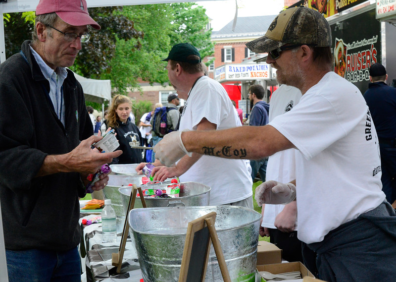 KRISTOPHER RADDER - BRATTLEBORO REFORMER<br /> Alton McCoy hands out free samples of yogurt at the Green Mountain Creamery tent during the Strolling of the Heifers Slow Living Expo in Brattleboro, Vt., on Saturday, June 3, 2017.