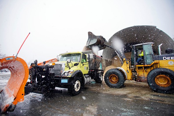 BEN GARVER — THE BERKSHIRE EAGLE<br /> A city plow is loaded with salt at the city yards on West Housatonic Street in Pittsfield during heavy snowfall, Wednesday, January 9, 2019. The city has two types of salt, the green salt is treated for low temperatures.