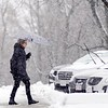 BEN GARVER — THE BERKSHIRE EAGLE<br /> A woman walks to her car on Main Street in Lenox, Mass., Wednesday, January 9, 2019.