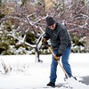 """BEN GARVER — THE BERKSHIRE EAGLE<br /> Gene Lagonia, facilities manager at the Lenox Library, cleans off the walks at the library, Wednesday, january 9, 2019. """"I didn't see this coming. It was raining early this morning, at 6:00 am I heard the plow and knew I had to get to work."""""""