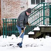 "BEN GARVER — THE BERKSHIRE EAGLE<br /> Gene Lagonia, facilities manager at the Lenox Library, cleans off the walks at the library, Wednesday, january 9, 2019. ""I didn't see this coming. It was raining early this morning, at 6:00 am I heard the plow and knew I had to get to work."""