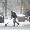 BEN GARVER — THE BERKSHIRE EAGLE<br /> Samir Abdallah shovels the walk in front of Hot Harries on North Street, Wednesday, March 7, 2018.