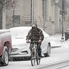 BEN GARVER — THE BERKSHIRE EAGLE<br /> A man bikes up North Street as the snow begins to accumulate, Wednesday, March 7, 2018.