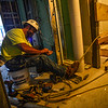KRISTOPHER RADDER — BRATTLEBORO REFORMER<br /> Paul Martocci II works on the wiring on the fifth floor of the Snow Block building, on Frost Street in Brattleboro.