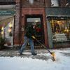 KRISTOPHER RADDER - BRATTLEBORO REFORMER<br /> John Clements shovels the sidewalk in front of a few Main Street business in Brattleboro during Thursday's snowstorm.