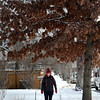 Boulder resident Christina Azzolina, 30, walks to work in  Boulder on Tuesday Jan. 29, 2013. DAILY CAMERA/ JESSICA CUNEO.