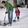 Boulder resident Oliver McBryan, 30, gets help shoveling snow from his daughter Scarlet, 4, in  Boulder on Tuesday Jan. 29, 2013. DAILY CAMERA/ JESSICA CUNEO.
