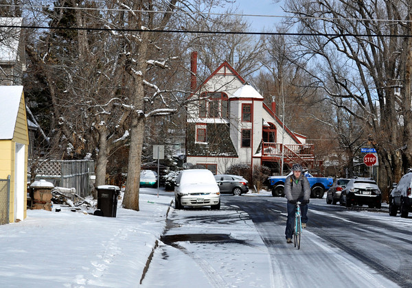 Boulder resident Sam Gastro, 28, rides his bike to work in  Boulder on Tuesday Jan. 29, 2013. DAILY CAMERA/ JESSICA CUNEO.