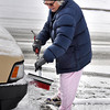 Boulder resident Marion Gately brushes snow off of her truck in  Boulder on Tuesday Jan. 29, 2013. DAILY CAMERA/ JESSICA CUNEO.