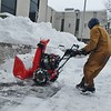 JENN SMITH — THE BEKRSHIRE EAGLE <br /> Dressed in heavy winter layers, Matt Sherman of A1 Incorporated works on clearing sidewalks with a snowblower outside some Main Street businesses in North Adams on Monday. Monday, December 2 2019