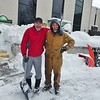 JENN SMITH — THE BEKRSHIRE EAGLE <br /> Steve Gavazzi, left, and Matt Sherman of A1 Incorporated pause for a photo op while clearing sidewalks outside some Main Street businesses in North Adams on Monday. Monday, December 2 2019