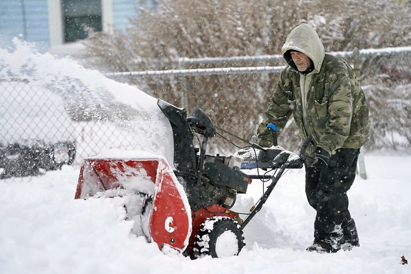 BEN GARVER — THE BERKSHIRE EAGLE<br /> Keith Standring clears snow for The Alternative Living Center on Maplewood Avenue in Pittsfield, Mass., Monday, December 2, 2019. Ben Garver/ The Berkshire Eagle