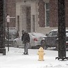 BEN GARVER — THE BERKSHIRE EAGLE<br /> A man crosses Melville Street in Pittsfield during heavy snowfall, Thursday, January 4, 2018. Snow is expected to give way to frigid temperatures for the next few days.