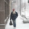 BEN GARVER — THE BERKSHIRE EAGLE<br /> Eugene Kirchner carries groceries home on North Street in Pittsfield during heavy snowfall, Thursday, January 4, 2018. Snow is expected to give way to frigid temperatures for the next few days.