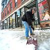 KRISTOPHER RADDER - BRATTLEBORO REFORMER<br /> Dan Unwin shovels the sidewalk in front of Taylor for Flowers Gowns on Elliot Street on Tuesday, Dec. 12, 2017.
