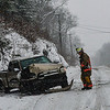 KRISTOPHER RADDER - BRATTLEBORO REFORMER<br /> West Dummerston Assistant Chief Richard Cogliano responds to a head-on motor vehicle collision on Route 5 in Dummerston next to Walker Farm on Tuesday, Dec. 12, 2017. No major injuries were reported.  The incident closed  Route 5 around 11 a.m. to allowed crews to cleanup.