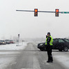 "A Lafayette police officer directs traffic in the snow at a broken traffic light on Wednesday, Dec. 19, at the intersection of Highway 287 and S. Public Road in Lafayette. For more photos of the snow storm go to  <a href=""http://www.dailycamera.com"">http://www.dailycamera.com</a><br /> Jeremy Papasso/ Camera"