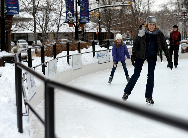 "Amy Robertson-Scripps, front, her daughter Eliza Scripps, 8, left, and sister Laurie Robertson have fun ice skating in the snowy weather at the Boulder Ice Rink on Wednesday, Dec. 19, on 13th Street in Boulder. For more photos of the snow storm go to  <a href=""http://www.dailycamera.com"">http://www.dailycamera.com</a><br /> Jeremy Papasso/ Camera"