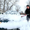 "Val Killpack, of Boulder, cleans the snow off his car on Wednesday, Dec. 19, in Boulder. For more photos of the snow storm go to  <a href=""http://www.dailycamera.com"">http://www.dailycamera.com</a><br /> Jeremy Papasso/ Camera"