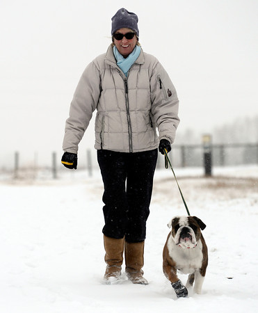 "Brenda Garnett, of Boulder, walks her dog Stella in the freshly fallen snow on Wednesday, Dec. 19, on the Dry Creek Trailhead in Boulder. For more photos of the snow storm go to  <a href=""http://www.dailycamera.com"">http://www.dailycamera.com</a><br /> Jeremy Papasso/ Camera"