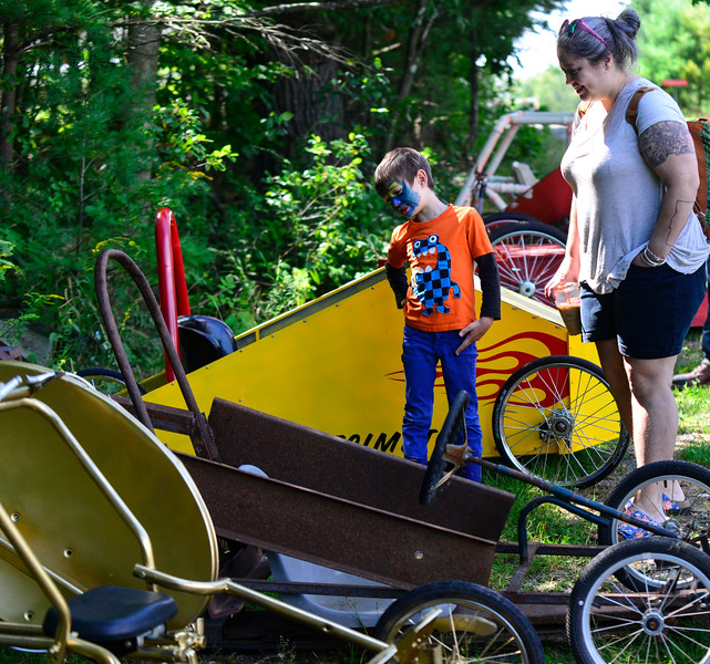 KRISTOPHER RADDER - BRATTLEBORO REFORMER<br /> Ellen Graham and her 6-year-old son, Ivan Lopez, look at the various soapbox derby cars on Sunday, Aug. 27, 2017.