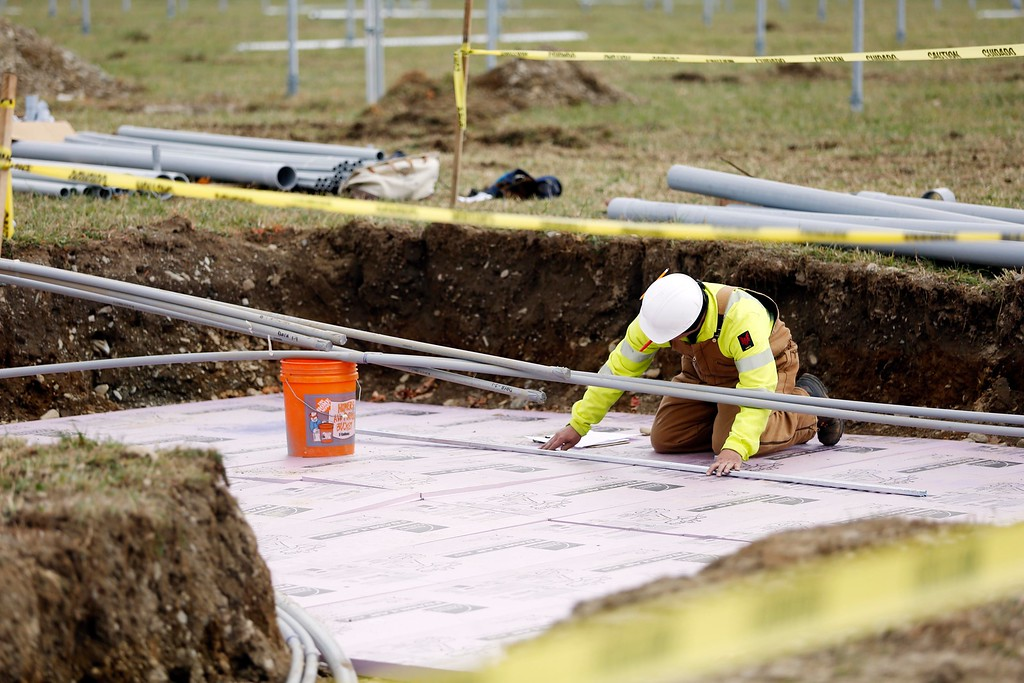 . Workers install the framework of a solar array at one of three sites on the Hancock Shaker Village property that have been allocated for solar projects. The sites, totaling nearly 30-acres, are part of a long-term lease to an outside company. Wednesday, October 26, 2016. Stephanie Zollshan � The Berkshire Eagle | photos.berkshireeagle.com