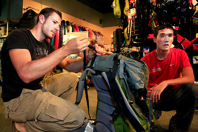 U.S. Army veteran Steve Baskis, at right, gets help from Nick Saylor before a training climb on St. Mary's Glacier at Bent Gate Mountaineering in Golden on Thursday, August 5.  To watch a video of the Soldiers to the Summit team getting geared up, visit www.dailycamera.com. Greg Lindstrom / The Camera
