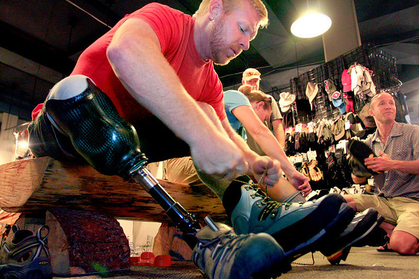 """U.S. Army veteran Chad Butrick tries on a pair of mountaineering boots before a training climb on St. Mary's Glacier at Bent Gate Mountaineering in Golden on Thursday, August 5.  To watch a video of the Soldiers to the Summit team getting geared up, visit  <a href=""""http://www.dailycamera.com"""">http://www.dailycamera.com</a>.<br /> Greg Lindstrom / The Camera"""