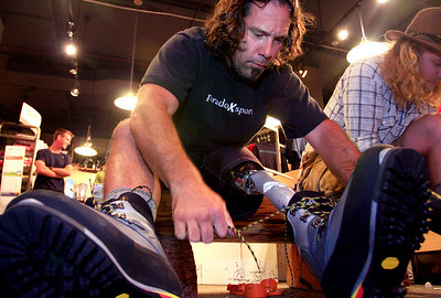 U.S. Army veteran Tom Carroll tries on a pair of mountaineering boots before a training climb on St. Mary's Glacier at Bent Gate Mountaineering in Golden on Thursday, August 5.  To watch a video of the Soldiers to the Summit team getting geared up, visit www.dailycamera.com. Greg Lindstrom / The Camera