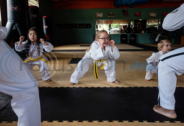 Noah Bui, 6, Ava Ward, 7, and Connor McIntosh, 5, train in Taekwondo in the Tiny Tigers class at Songahm Martial Arts Academy in Tyler on July 1, 2020.
