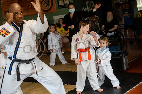 McIntosh siblings Patrick, 8, helps his little sister Willow, 3, as Master Dometrius Hill leads the Tiny Tigers Taekwondo class at Songahm Martial Arts Academy in Tyler on July 1, 2020.