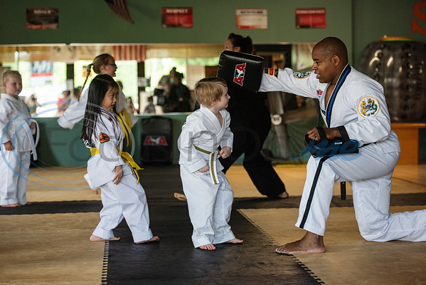 Connor McIntosh, 5, of Tyler, practices ducking with Master Dometrius Hill at Songahm Martial Arts Academy in Tyler on July 1, 2020. Connor has ADHD and Autism. Songahm Martial Arts Academy's classes are inclusive to children and adults of all abilities including behavior issues, physical differences, amputees, Down syndrome and cognitive differences. They also offer private lessons.