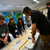 KRISTOPHER RADDER — BRATTLEBORO REFORMER<br /> John DiMatteo helps out students with the construction of their towers during the Sophomore Summit at S.I.T. on Wednesday, April 10, 2019.