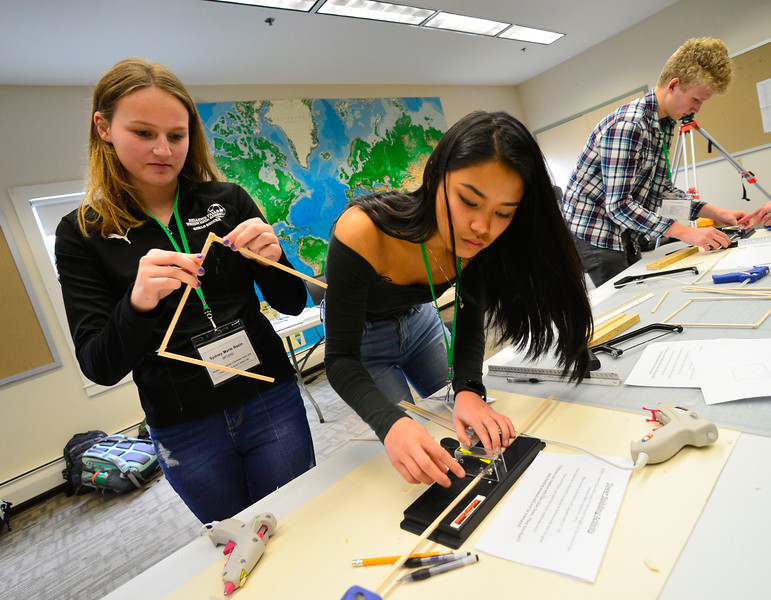 KRISTOPHER RADDER — BRATTLEBORO REFORMER<br /> Molly Xiao Hua Hodsden and Sydney Marie Bazin, sophomores at Bellows Falls Union High School, make a cut while building a tower during the Sophomore Summit at S.I.T. on Wednesday, April 10, 2019.