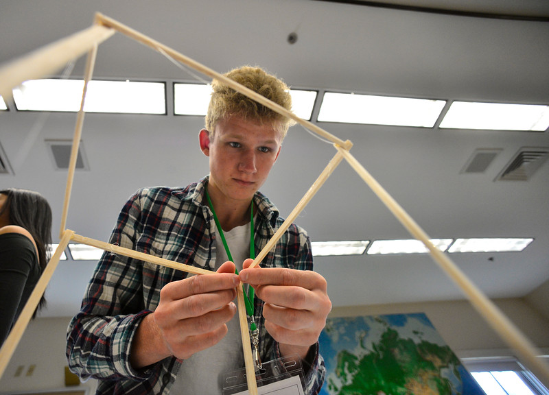KRISTOPHER RADDER — BRATTLEBORO REFORMER<br /> Finnlay Fisher, a sophomore at Twin Valley Middle High School, focus on building his town during the Sophomore Summit at S.I.T. on Wednesday, April 10, 2019.