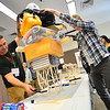 KRISTOPHER RADDER — BRATTLEBORO REFORMER<br /> John DiMatteo helps students put weight onto their towers as to see how much weight it could hold.