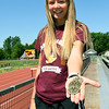 Girard's Cailie Logue holds her four state championship medals -in the 3200m, 1600m, 800m and 4x800m relay -  on Friday at Girard High School.<br /> Globe | Laurie Sisk