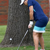 Kelli Frazier, of Webb City, hits a chip shot onto the no. 2 green on Tuesday morning at Twin Hills.<br /> Globe | Laurie Sisk