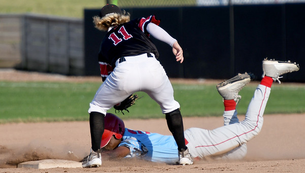 Outlaws shortstop Jeff Wetzler (11) tags out Clarinda's Jacob Edwards (25) on an attempted steal during their game on Friday night at Joe Becker Stadium.<br /> Globe | Laurie Sisk