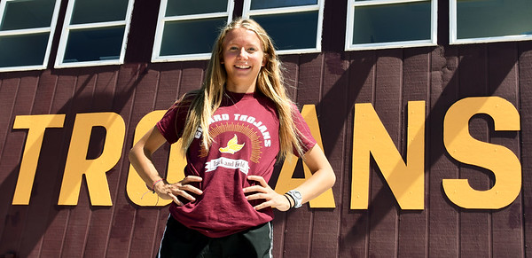 Fresh off four state championship performances - in the 3200m, 1600m, 800m and 4x800m relay - Girard's Cailie Logue poses for a photo on Friday at Girard High School.<br /> Globe | Laurie Sisk