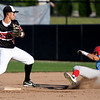 Outlaws second baseman Kaleb Delatorre (20) completes the front end of a double play as Clarinda's Mondesi Gutierrez (3) slides into the bag during their game on Friday night at Joe Becker Stadium.<br /> Globe | Laurie Sisk