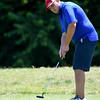 Mark Bruder watches the ball roll toward the cup on the no. 1 green as he begins defense of his Briarbrook Invitational title on Friday afternoon.<br /> Globe | Laurie Sisk