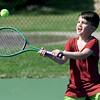 Five-year-old Ian Markley prepares to return a serve as he tackles tennis for the first time on Thursday afternoon at Ewert Park.<br /> Globe | Laurie Sisk