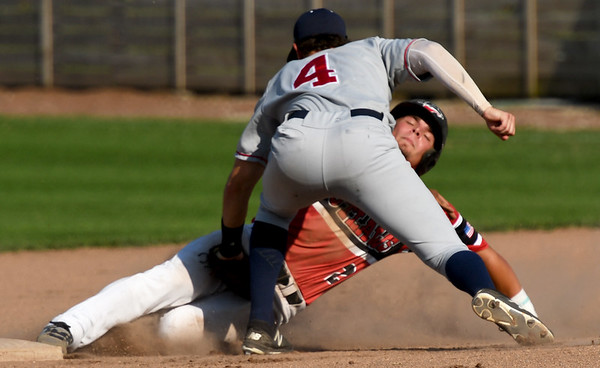 Ozark's Jordan Martin (4) tags out Joplin's Zack Ehlen (2) on a stolen base attempt at second during their game on Tuesday night at Joe Becker Stadium.<br /> Globe | Laurie Sisk